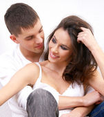 Young loving couple over white background — Stock Photo