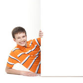 Boy with the blank banner — Stock Photo