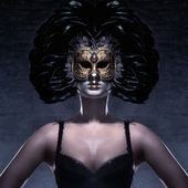 Young attractive woman in mask over dark background — Stock Photo