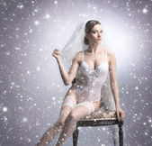 Young sexy bride in erotic lingerie over Christmas background — Stock Photo