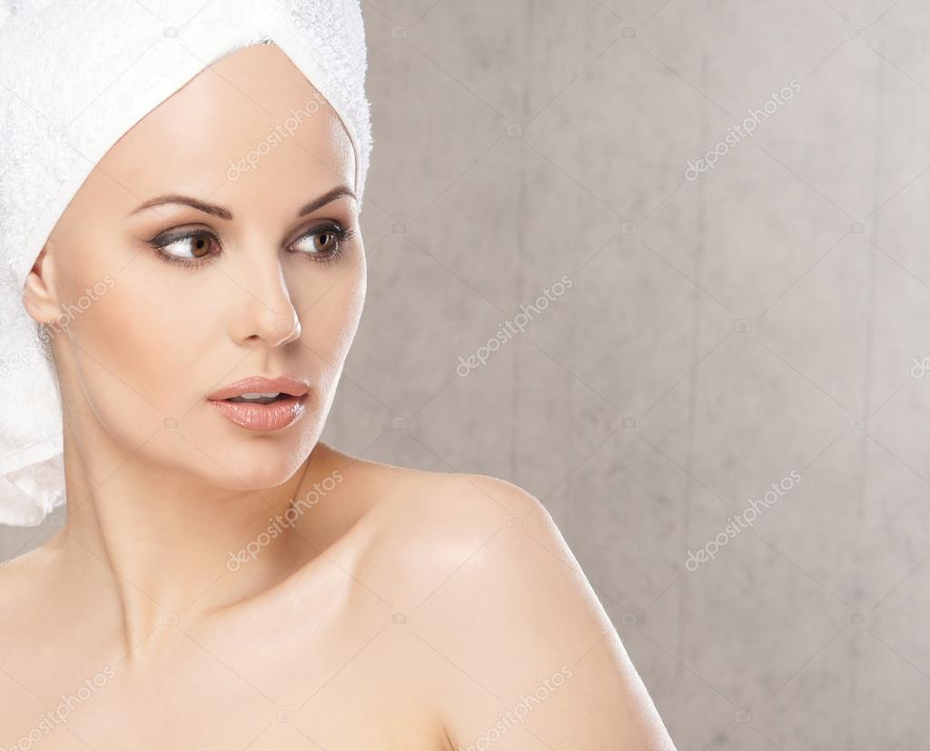 Spa portrait of young attractive woman in towel  Stock Photo #15521457