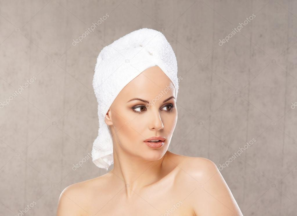 Spa portrait of young attractive woman in towel — Photo #15521469