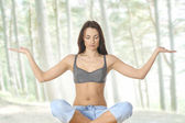 Young fit brunette meditating — Stock Photo