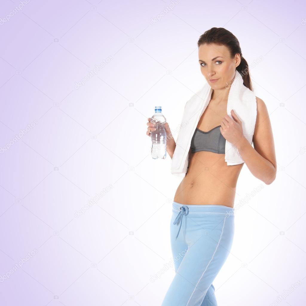 Young beautiful female sportsman over blue background — Stock Photo #15601371