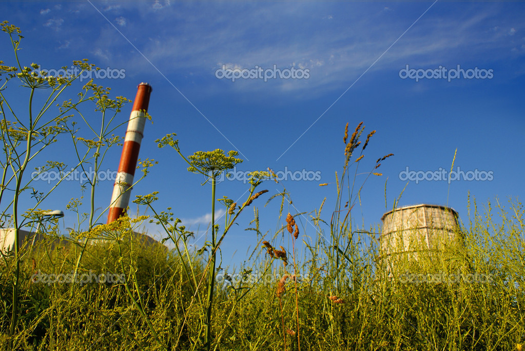 Green field on a background of industrial station       — Stock Photo #15601597