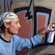 Graffity painter drawing a picture - Stock Photo