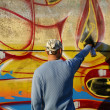 Stock Photo: Graffity painter drawing picture