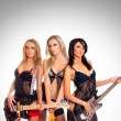 Sexy female music band — Stock Photo