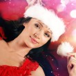 Young and sexy woman wearing erotic lingerie in Christmas style — Stock Photo #15758411