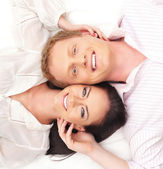 Young happy couple over white background — Stock Photo