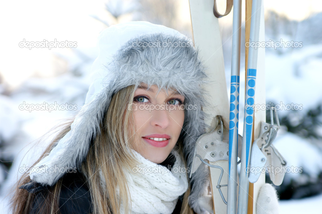 Attractive woman with ski over winter background — Stock Photo #15762955