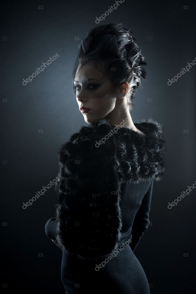 Portrait of female vampire over dark background — Stockfoto #15763789
