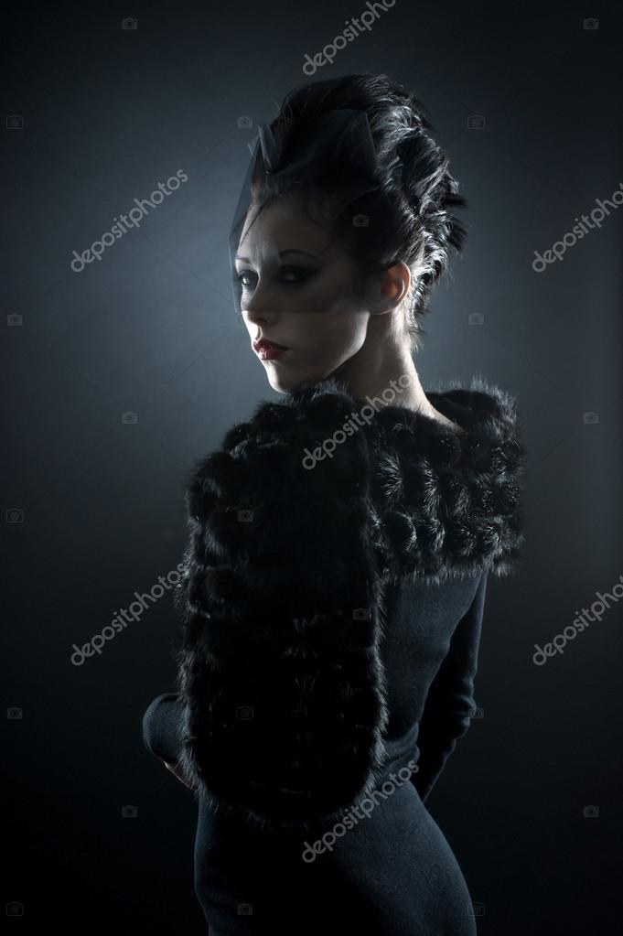 Portrait of female vampire over dark background  Foto de Stock   #15763789