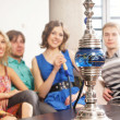 Foto Stock: Smoking hookah. WARNING! The focus is only in hookah!