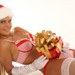 Young sexy Santa with a gift isolated on white — Stock Photo