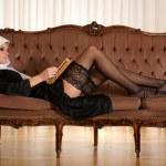 Sexy nun reading Bible — Stock Photo