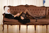 Sexy nun reading Bible — Stock Photo