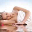 Young and beautiful blond in towel — Stock Photo #15836777