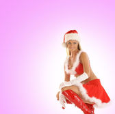 Young sexy Santa isolated on pink — Stock Photo