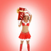 Young sexy Santa isolated on red — Stock Photo