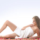 Young and beautiful blond in towel — Stock Photo