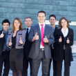 Stock Photo: Business team over modern background