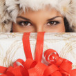 Young and beautiful woman holding a nice Christmas present over — Стоковая фотография