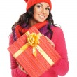 Young and beautiful woman holding a nice Christmas present over white background — Stock Photo #15869575