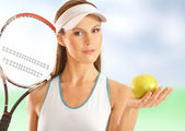 Young fit tennis player — Stock Photo