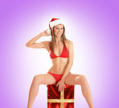 Young sexy Santa in bikini — Stock Photo