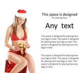 Young sexy Santa sitting on a big present — Стоковое фото
