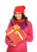 Young and beautiful woman holding a nice Christmas present over white background — Stock Photo