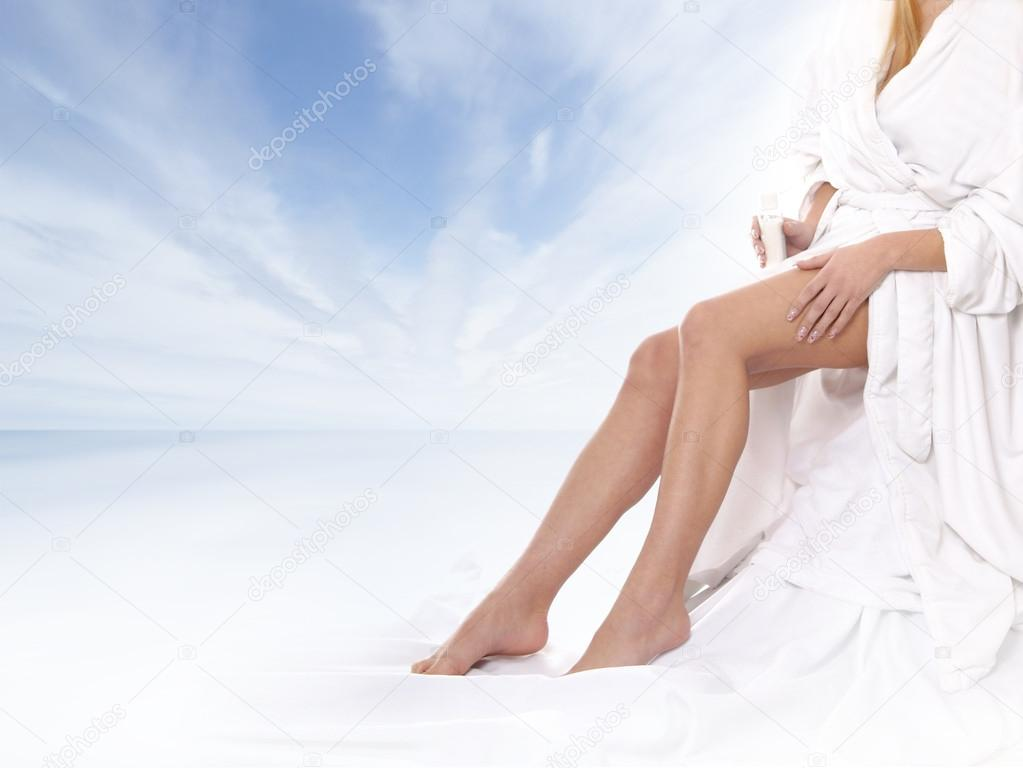 Sexy legs of young beautiful woman over natural background — Stock Photo #15866615