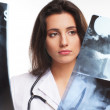 Young attractive female doctor isolated over white background — Stock Photo