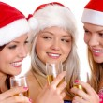 Three young girls celebrate Christmas — Stock Photo