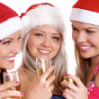 Three young girls celebrate Christmas — Stockfoto