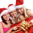 Three young girls celebrate Christmas — ストック写真