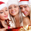 Three young girls celebrate Christmas — Stock Photo #15874123
