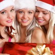 Stok fotoğraf: Three young girls celebrate Christmas