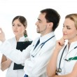 Team of young and smart medical workers — Foto de stock #15875713