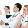 Foto Stock: Team of young and smart medical workers