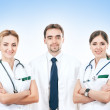 Team of young and smart medical workers — Stock Photo #15875793