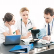 Group of medical workers discussing in office — Stock Photo #15875859