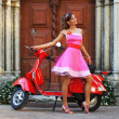 Young attractive girl with a scooter - Stock Photo