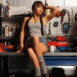 Young and sexy woman in garage — Stock Photo #15876019