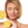 Portrait oy young and healthy woman with orange — Stock Photo
