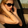 Sexy woman in the car — Stock Photo