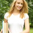 Young beautiful girl with some books — Stock Photo