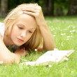 Young beautiful girl reading — Stock Photo #15878385
