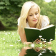 Young beautiful girl reading — Stock Photo